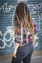 Rear view of young woman with dreadlocks - LFEF00021