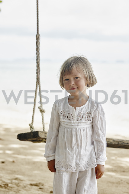 Thailand, Ko Yao Noi, portrait of little girl at a swing on the beach - RORF01089