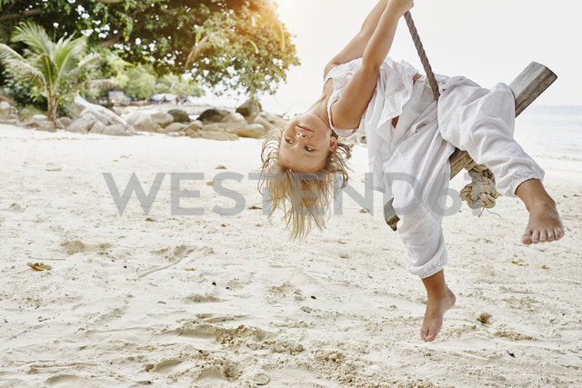 Thailand, Phi Phi Islands, Ko Phi Phi, little girl on a rope swing on the beach - RORF01101