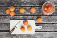Apricots on garden table - GWF05402