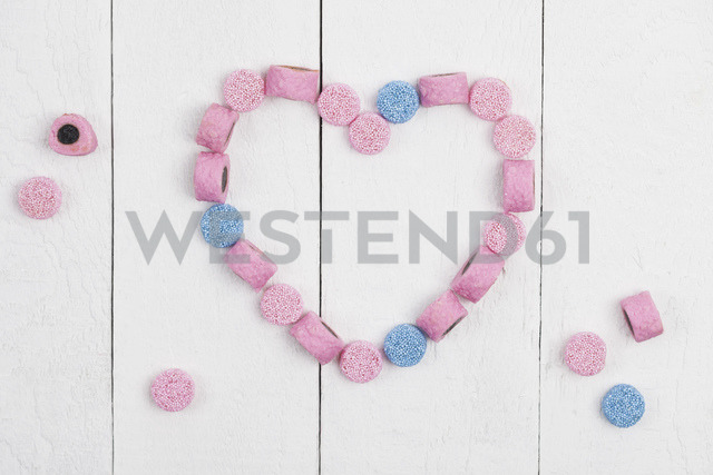 British licorice, heart on wooden background - GWF05405