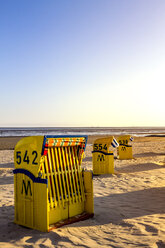 Germany, Schleswig-Holstein, Husum, closed hooded beach chair - PUF01174