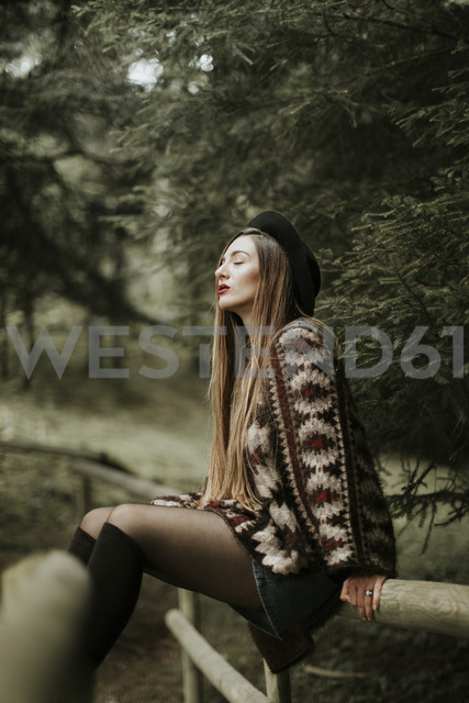 Fashionable young woman relaxing in the woods - OCAF00086