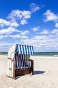 Germany, Mecklenburg-Western Pomerania, Boltenhagen, hooded beach chair at beach - PUF01183
