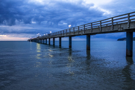 Germany, Mecklenburg-Western Pomerania, Baltic sea seaside resort Binz, pier at blue hour - PUF01188