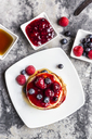 Pancakes with red fruit jelly, maple sirup, raspberry and blueberry - SARF03505