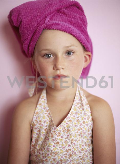 Portrait of little girl wearing pink towel turban - FSF00989