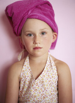 Portrait of little girl wearing pink towel turban - FSF00989