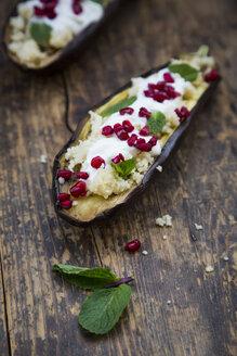 Filled aubergine, couscous, yogurt sauce, mint and pomegranate seeds - LVF06648