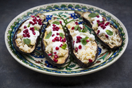 Filled aubergine, couscous, yogurt sauce, mint and pomegranate seeds - LVF06651