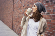 Happy woman with coffee to go - BSZF00217