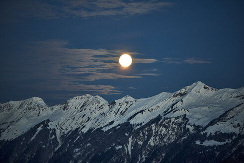 Switzerland, Bern, Hasliberg, moon over snowcapped mountains - JEDF00300
