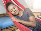 Smiling young woman sleeping in hammock - MADF01393