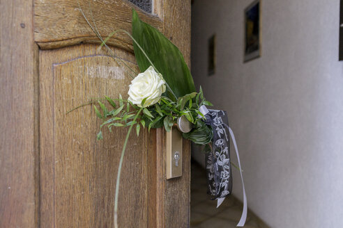 Farewell flower at entrance door of an apartment - KMKF00151