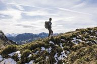 Austria, Tyrol, young man hiking in the mountains - UUF12544