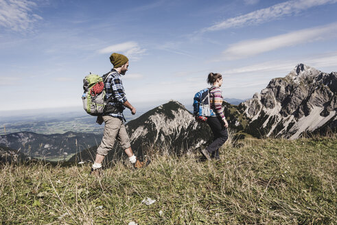 Austria, Tyrol, young couple hiking in the mountains - UUF12547
