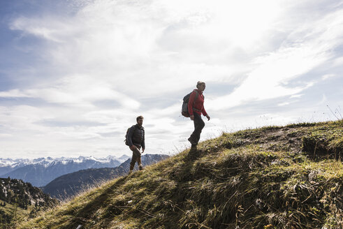 Austria, Tyrol, young couple hiking in the mountains - UUF12556