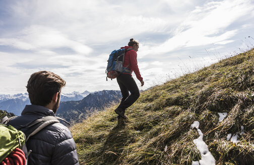 Austria, Tyrol, young couple hiking in the mountains - UUF12559
