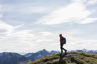 Austria, Tyrol, young woman hiking in the mountains - UUF12568