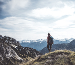 Austria, Tyrol, young woman hiking in the mountains - UUF12571