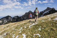 Austria, Tyrol, young couple hiking in the mountains - UUF12586