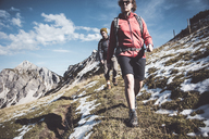 Austria, Tyrol, young couple hiking in the mountains - UUF12589