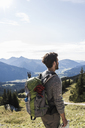 Austria, Tyrol, young man in mountainscape looking at view - UUF12592