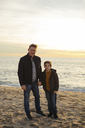 Portrait of father and son standing on the beach - EBSF02030