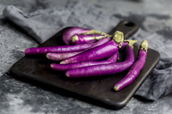 Aubergines, Aubergine Perlina, on chopping board - SARF03520