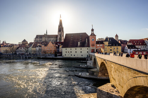 Germany, Regensburg, view to cathedral at the old town with Steinerne Bruecke over Danube river - PUF01267