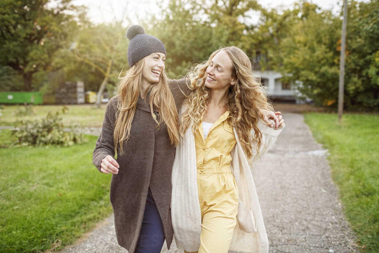 Two happy women walking in rural landscape - PESF00910 - Peter Scholl/Westend61