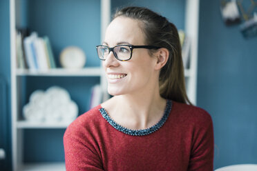Portrait of happy woman wearing glasses - MOEF00729