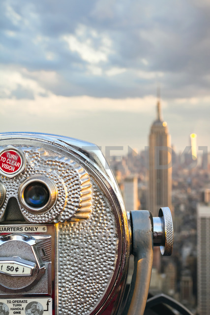 USA, New York, Manhattan, Close up of telescope, Empire State Building in background - DAPF00877