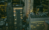 USA, New York, Manhattan, high-rise buildings at night - DAPF00880