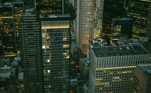 USA, New York, Manhattan, high-rise buildings at night - DAPF00880