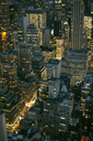 USA, New York, Manhattan, high-rise buildings at night - DAPF00883