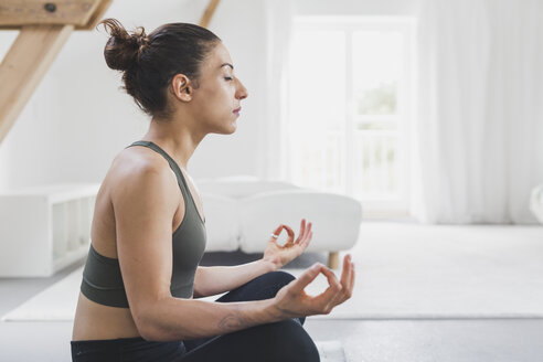 Woman sitting practicing yoga - ASCF00787