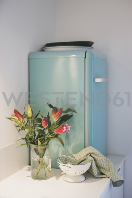 Bunch of flowers and refrigerator in kitchen - ASCF00790
