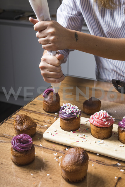 Woman preparing muffins at home - MAUF01274
