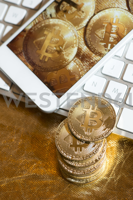 Bitcoin, metal coins, keyboard and smartphone - DEGF00954