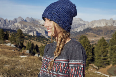 Portrait of happy young woman hiking in the mountains - PNEF00452