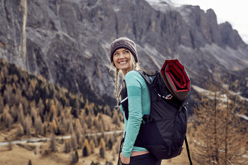 Portrait of happy young woman hiking in the mountains - PNEF00476