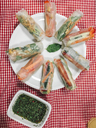 vegan vietnamese springrolls, filled with bell pepper,carrots,cucumber,mint,cilantro,roasted peanuts,roasted onions and spring onions with spicy dip - IPF00437