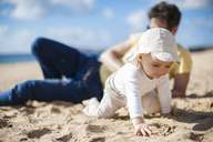 Spain, Lanzarote, baby girl crawling on the beach - DIGF03233