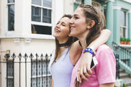 Two happy teenage girls on the go in the city - WPEF00013