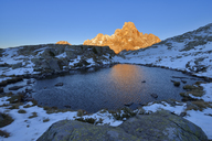 Italy, Trentino, Dolomites, Passo Rolle, Pale di San Martino range, mountain peak Cimon della Pala in the evening light - RUEF01809