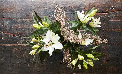 Cut flowers on dark wood, top view - FMKF04780