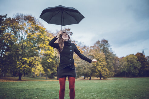 Young woman with umbrella in autumnal park - JSCF00027