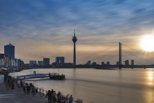 Germany, North Rhine-Westphalia, Duesseldorf, Rhine Tower, Rhine riverbank, high water in the evening - FRF00633