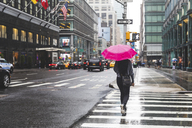 USA, New York, woman in the city on a rainy day - WPEF00043